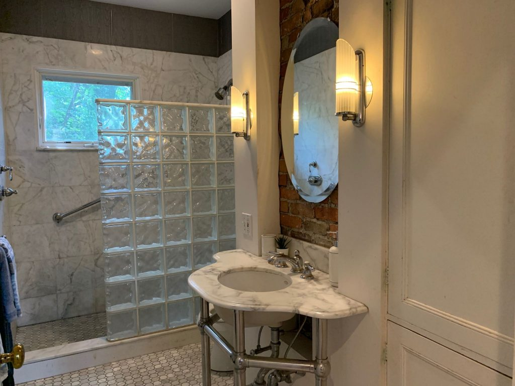 Updated baths with marble and large shower